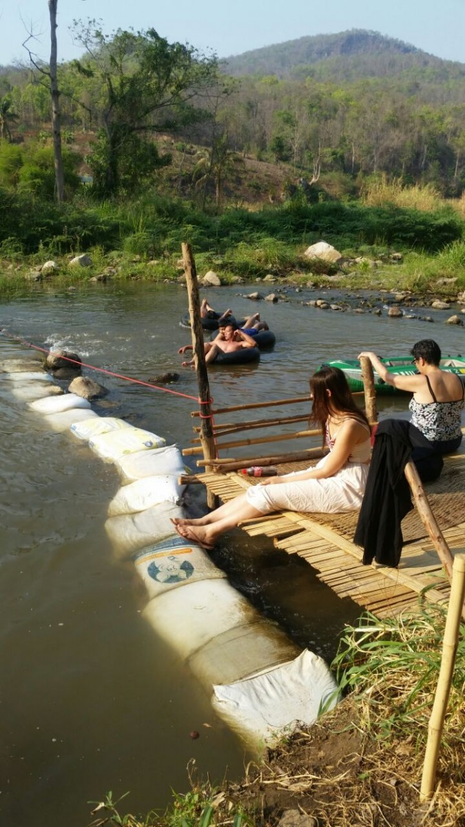 Having Fun in the Bamboo Bridge River In Pai